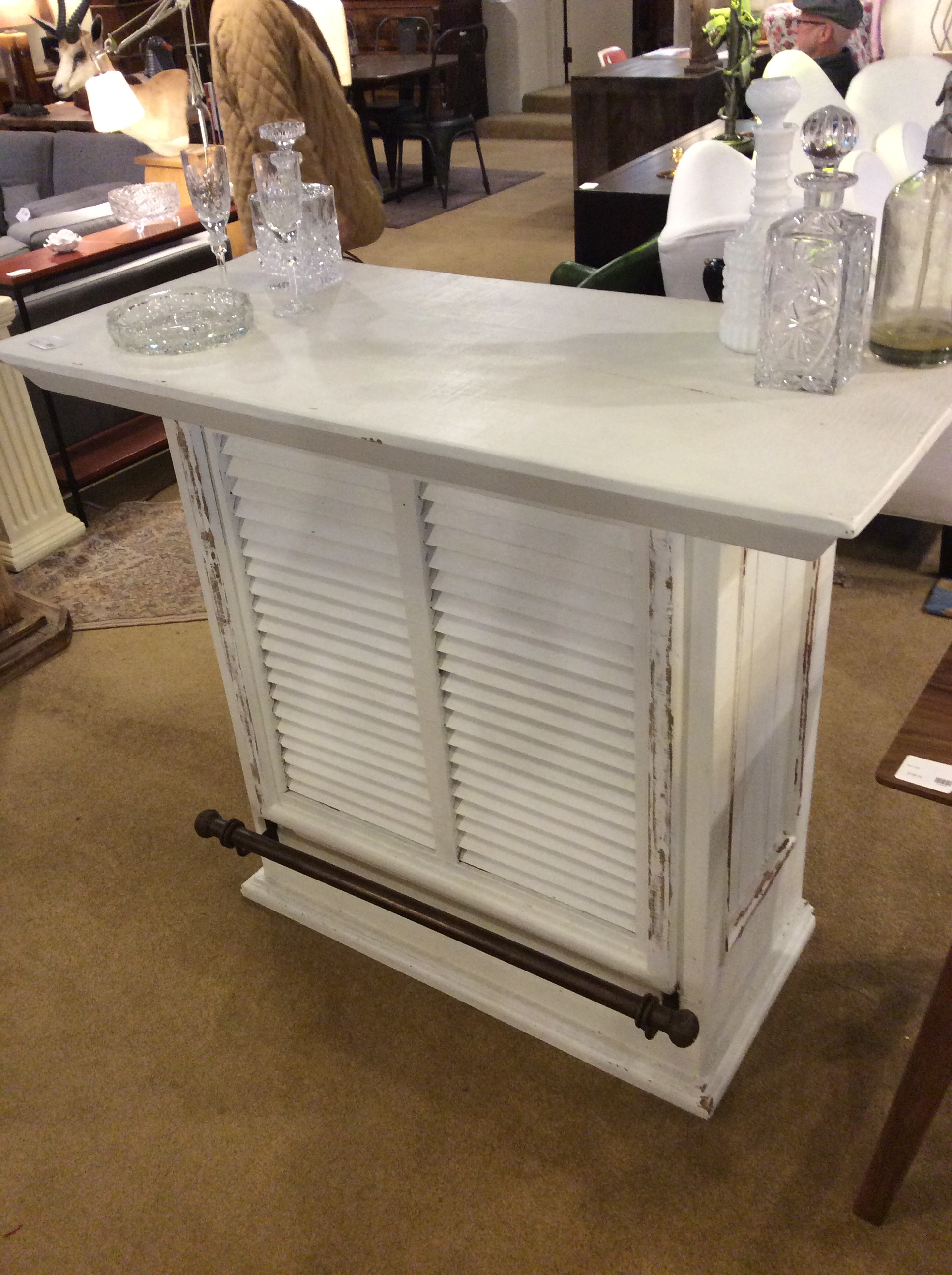 Description: White Rustic Bar Cabinet.